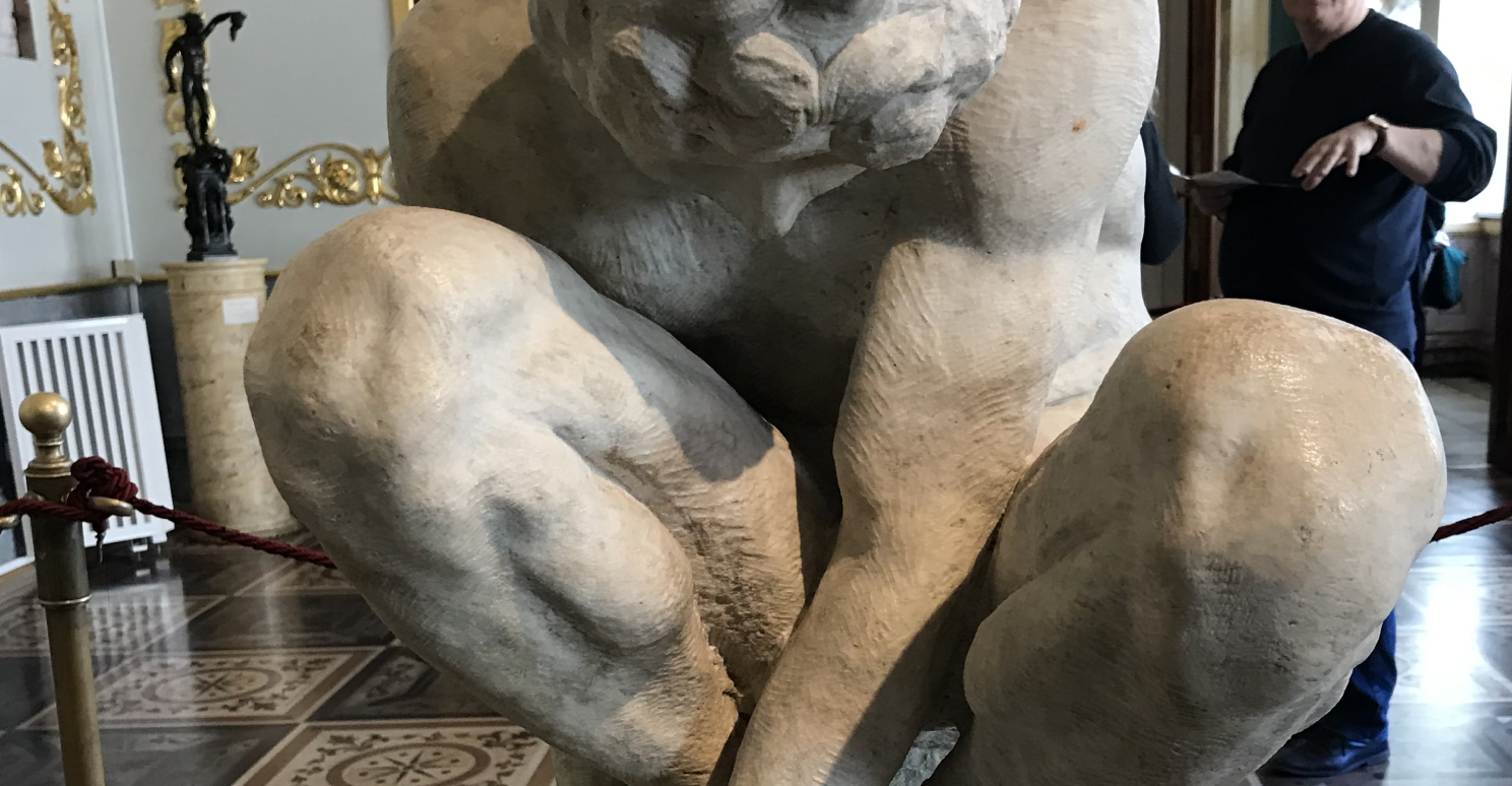 the crouching boy by Michelangelo