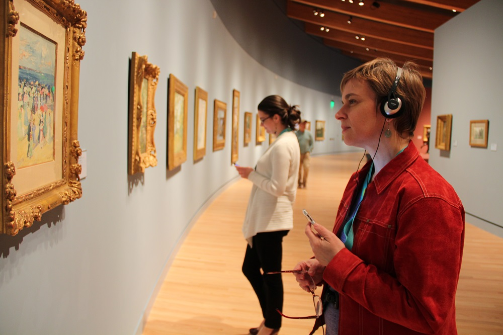 woman with audio guide in the museum
