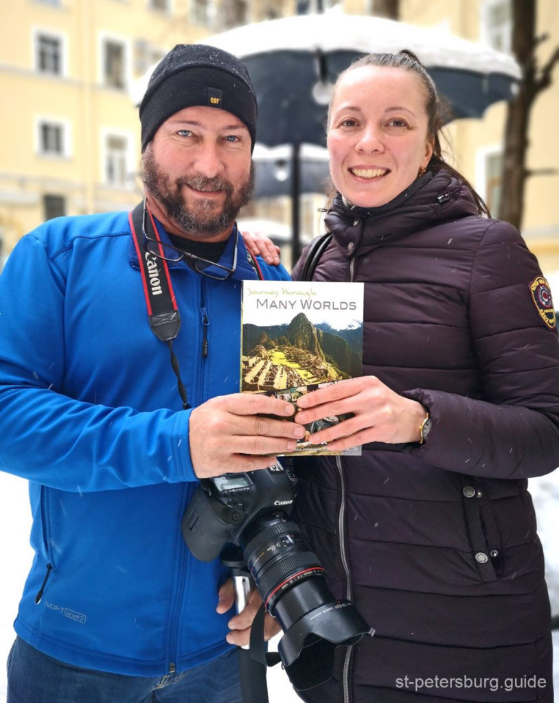 an author presenting his book to st petersburg tour guide