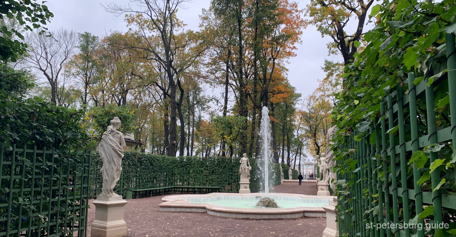 Working fountain and the statues in Summer Garden. Autumn walk in the heart of Saint Petersburg