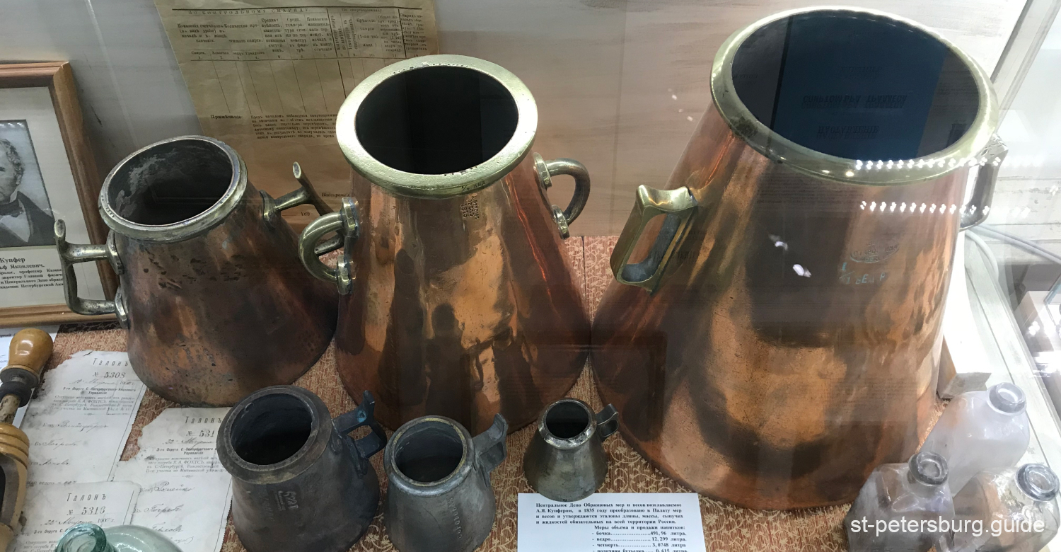Differently sized buckets for vodka in the Russian Vodka Museum in Saint Petersburg