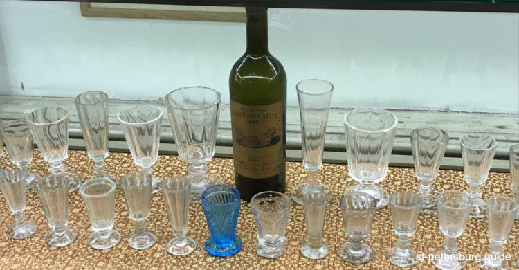 Exhibits of Russian Vodka Museum in Saint Petersburg. Bottle and shot glasses of different styles and designs
