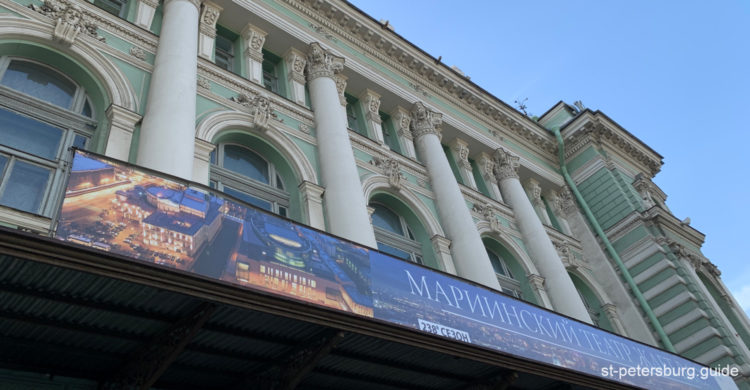 On the entrance to Mariinsky Theatre. Green and white facades and the season announcing banner. Saint Petersburg Russia