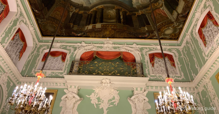 Green ball room with decorations of fletwork. Stroganov Palace in St Petersburg Russia