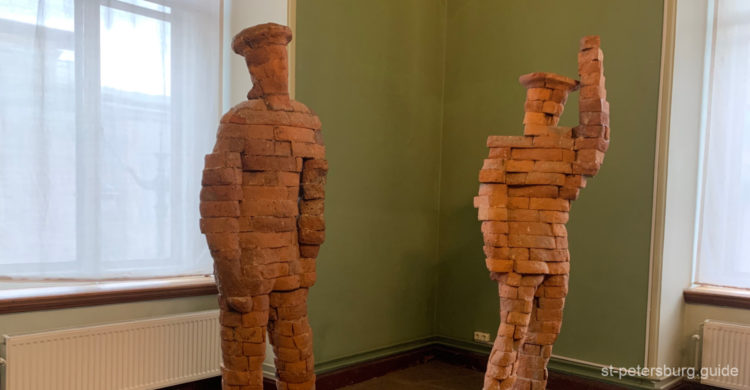 Seamen sculptures made of brick. Marble Palace in St Petersburg Russia