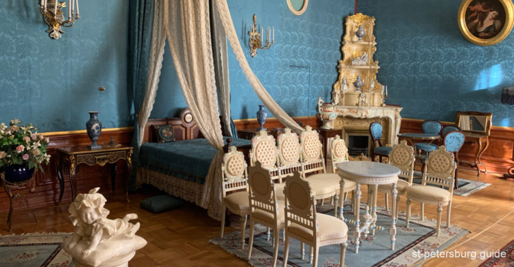 Blue-colored bedroom with luxe interior design. Yusupov Palace in Saint Petersburg Russia