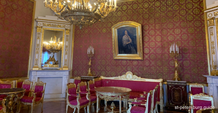 Red seating room with plush interior design. Yusupov Palace in Saint Petersburg Russia