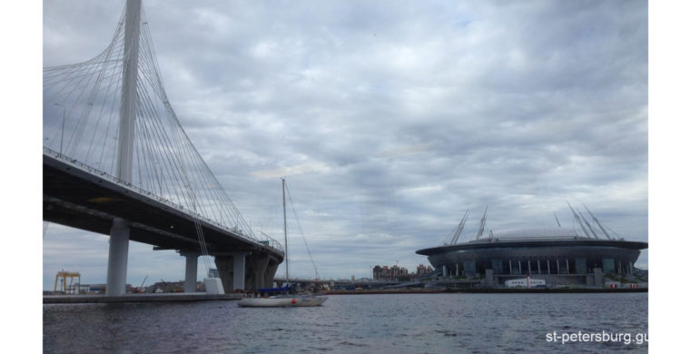 Water view on the bridge and Gazprom Arena in Saint Petersburg