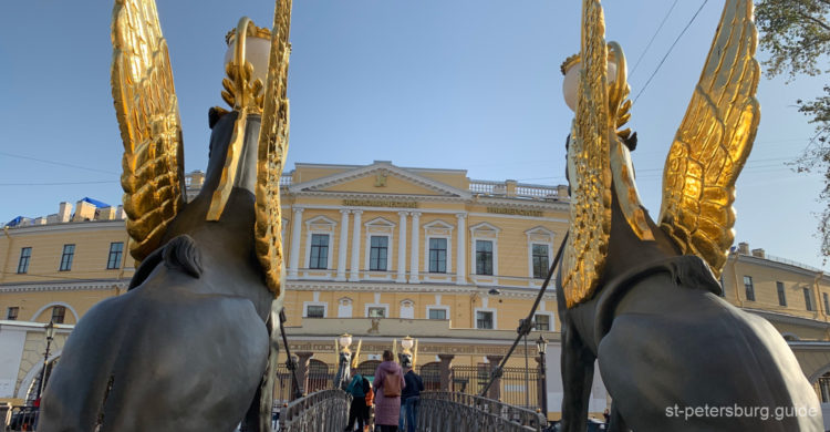 The back side of Griffins and the Economy University view. Bank bridge in Saint Petersburg Russia