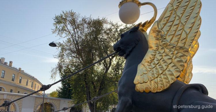 Golden-winged griffin of the Bank Bridge in Saint Petersburg Russia