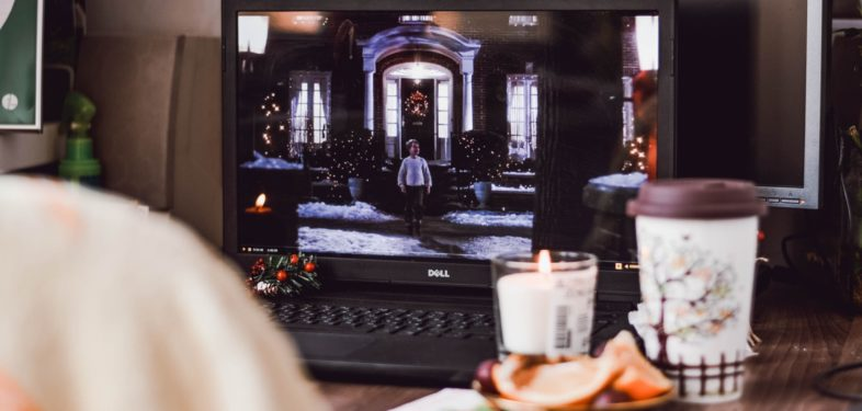 Watching Christmas movies on a laptop