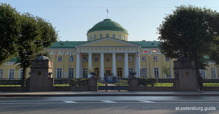 External view of the Taurida Palace. Yellow facades of the palace with six white Corinth columns are protected by a stylish fence. Saint Petersburg Russia