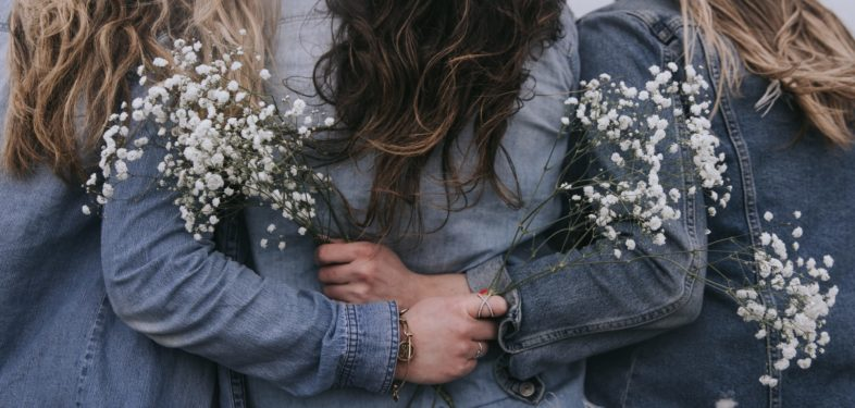 Girls with flowers standing together