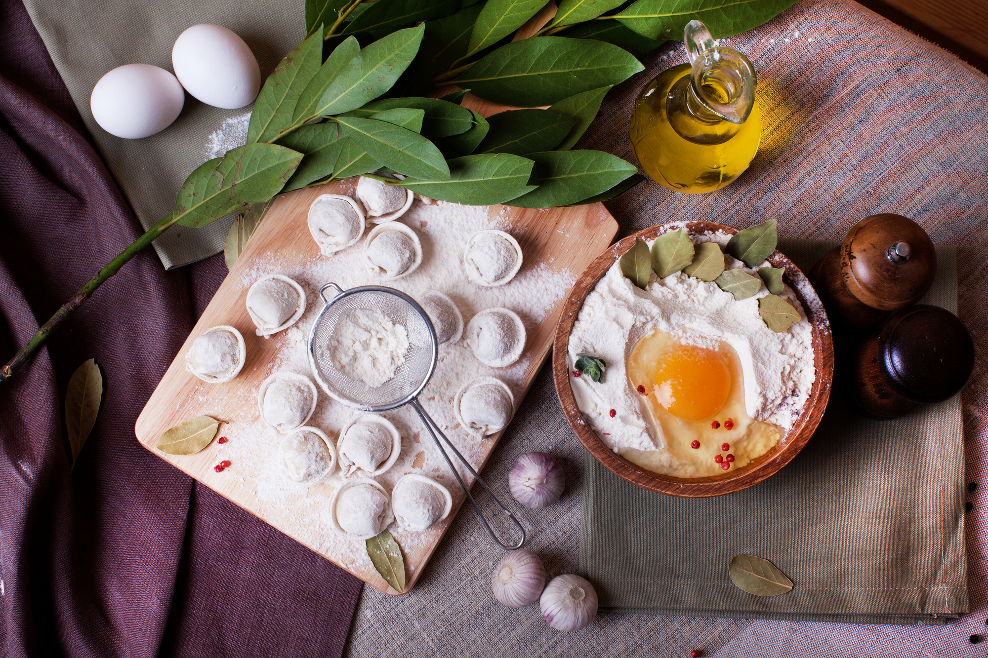 Table covered with ingredients and ready-made dumplings
