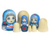Three traditional Russian matryoshka dolls and blanks for painting