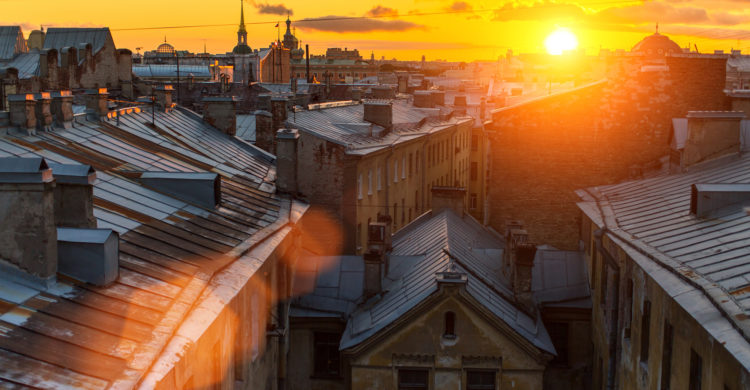 View of Roofs of the old town in St. Petersburg during beautiful sunset.
