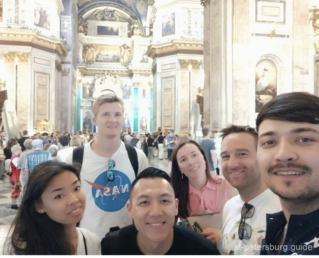 Friends on a tour with St Petersburg guide in St Isaac's Cathedral, Russia