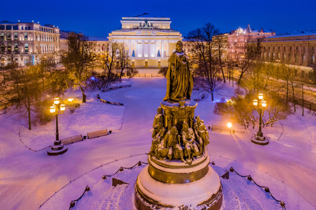 Saint Petersburg. Russia. The monument to Catherine the great in Ostrovsky square. Alexandrinsky theater with Christmas trees and festive illumination. View from the drone on the square. Christmas.